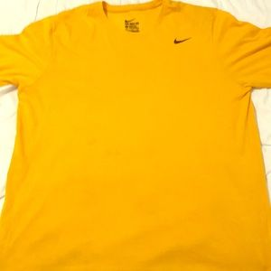 Yellow men's Nike tshirt with 2 small stains